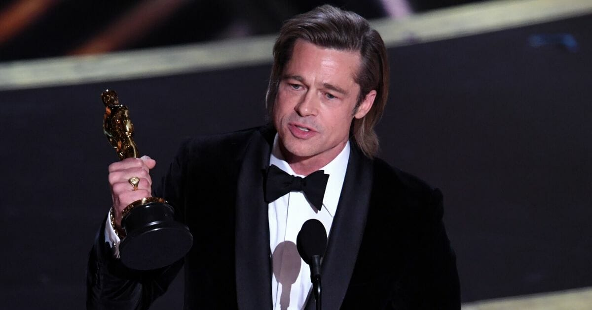 Brad Pitt accepts the Oscar for best actor in a supporting role for 'Once Upon a Time ... in Hollywood' during the Academy Awards at the Dolby Theatre in Hollywood, California, on Feb. 9, 2020.