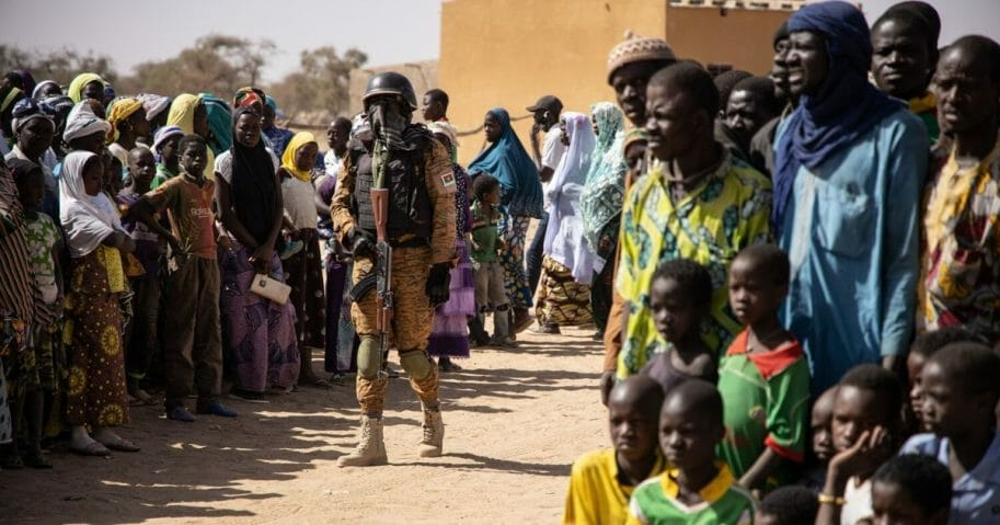 A Burkina Faso soldier patrols at district welcoming internally displaced people from northern Burkina Faso in Dori, on Feb. 3, 2020.