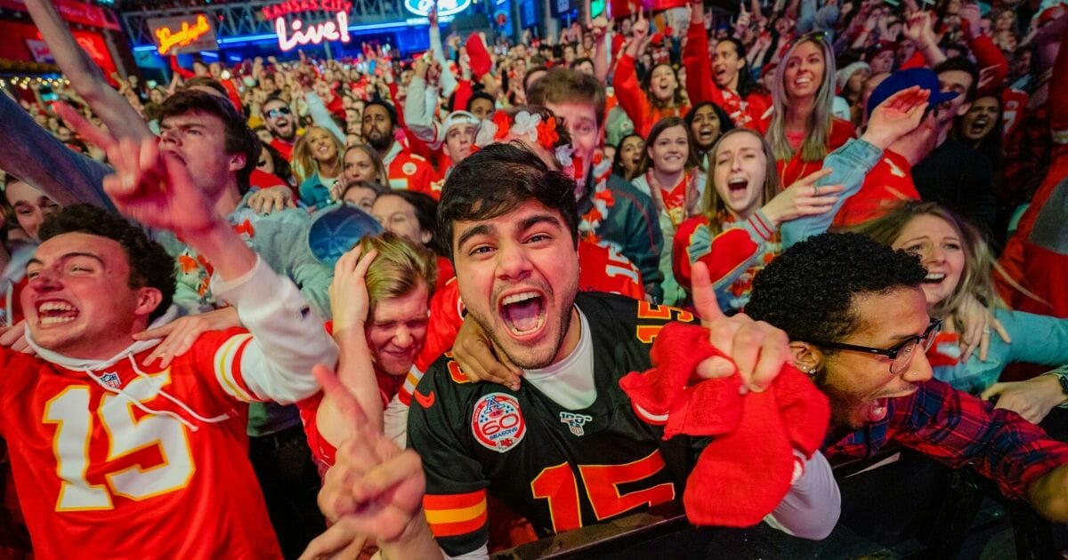 Chiefs fans at the Power and Light District in Kansas City, Kansas, celebrate their team's victory over the San Francisco 49ers in Super Bowl LIV on Feb. 2, 2020.