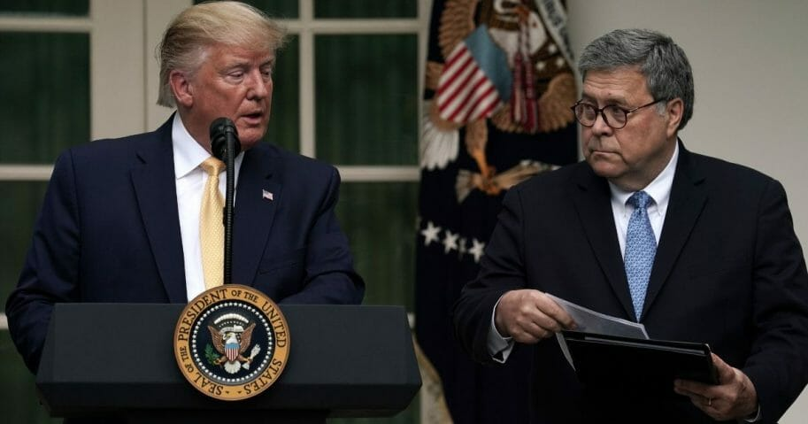 President Donald Trump, left, makes a statement on the census with Attorney General William Barr in the Rose Garden of the White House on July 11, 2019, in Washington, D.C.