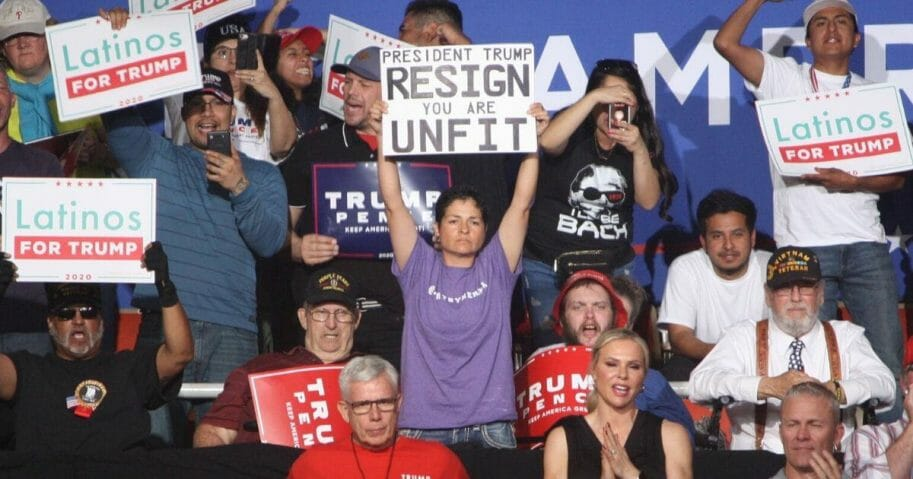 A protester holds a sign at President Donald Trump's rally in Phoenix on Feb. 19, 2020.