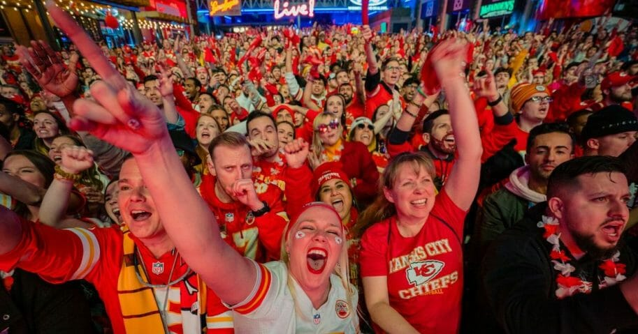 Fans cheer on the Chiefs at the Power and Light District as the Kansas City Chiefs play the San Francisco 49ers in the Super Bowl on Feb. 2, 2020, in Kansas City, Kansas.