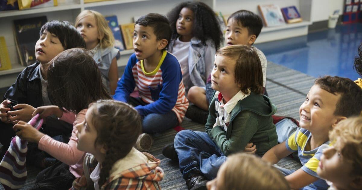 Kindergarten students sitting on the floor.