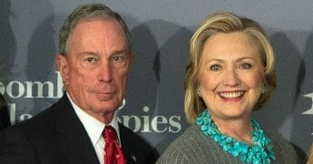 Former New York City Mayor Michael Bloomberg, left, and former Secretary of State Hillary Clinton are seen at Bloomberg Philanthropies on Dec. 15, 2014, in New York City.
