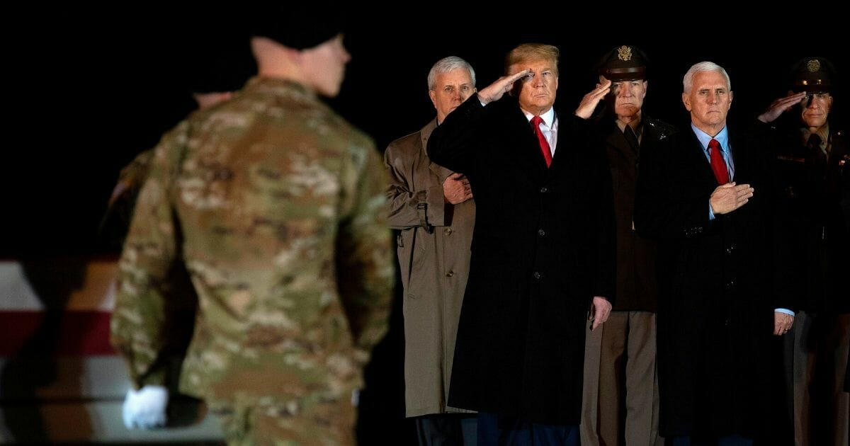 President Donald Trump and Vice President Mike Pence observe the dignified transfer of two U.S. soldiers, killed in Afghanistan, at Dover Air Force Base in Delaware, on Feb. 10, 2020.