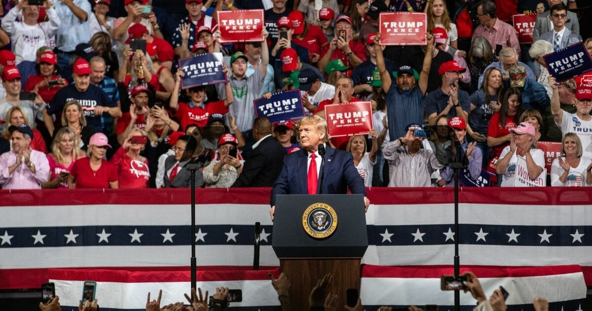 Supporters cheer as President Donald Trump speaks during a rally at the Arizona Veterans Memorial Coliseum in Phoenix on Feb. 19, 2020.