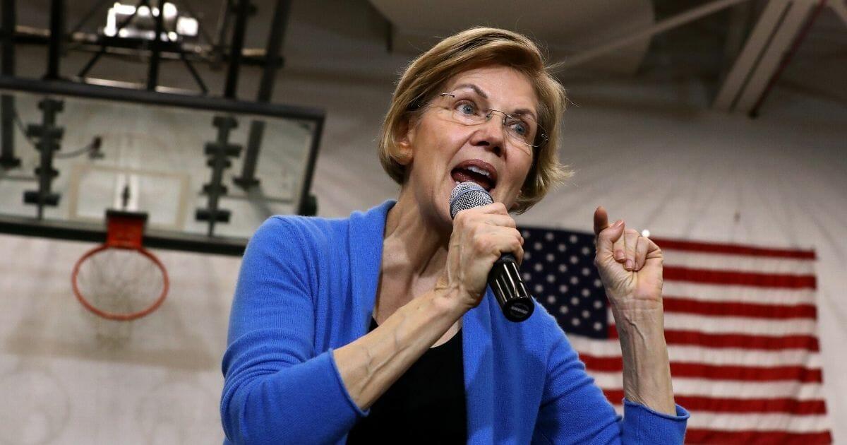 Massachusetts Sen. Elizabeth Warren delivers a speech Saturday in Iowa City, Iowa.