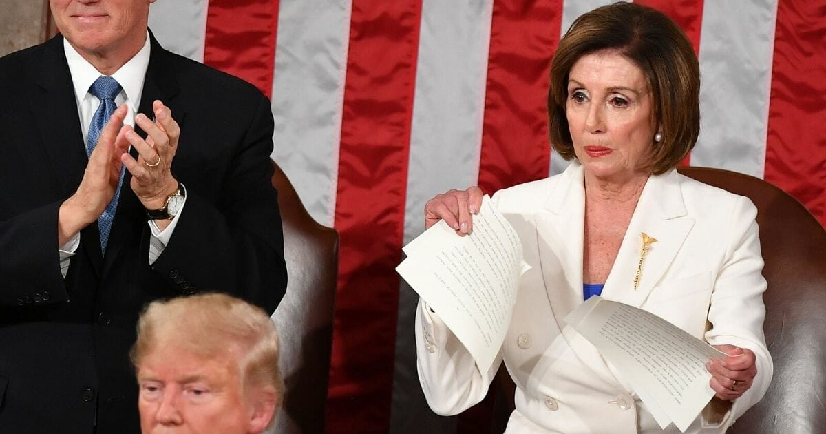 House Speaker Nancy Pelosi rips her copy of President Donald Trump's State of the Union address on Tuesday.