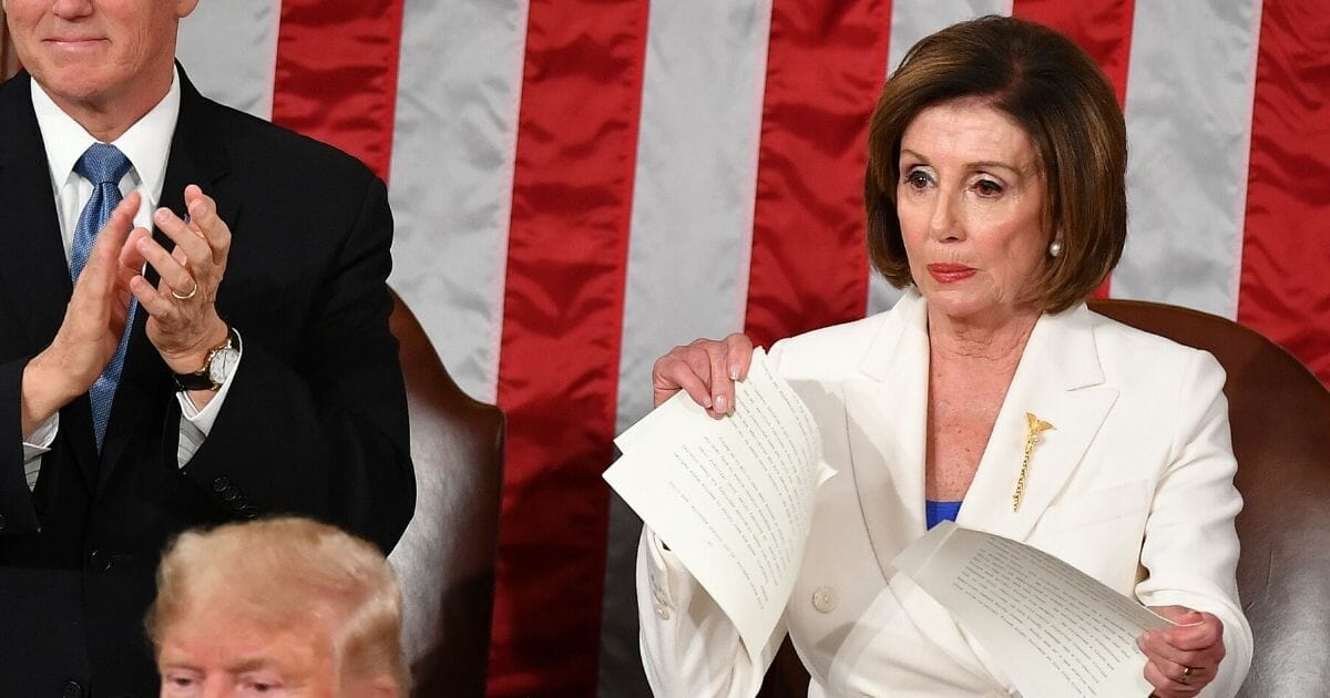 House Speaker Nancy Pelosi rips up her copy of President Donald Trump's State of the Union address on Tuesday.