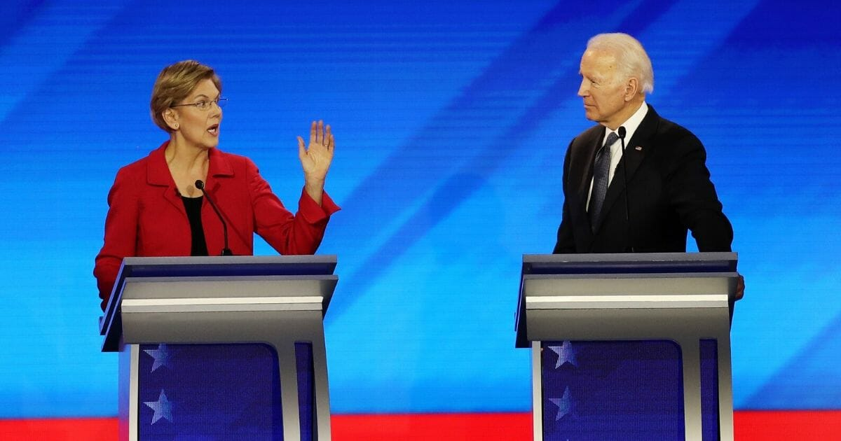 Massachusetts Sen. Elizabeth Warren, left, and former Vice President Joe Biden on stage at Friday night's Democratic primary debate at St. Anselm Collegle in Manchester, New Hampshire.