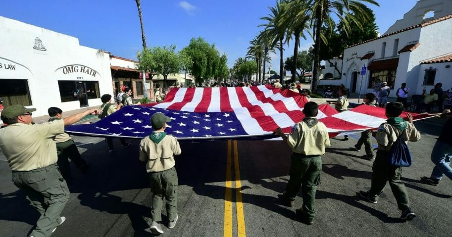 A Boy Scout troop carries the flag during a July 4 parade in San Gabriel, California, in 2018.