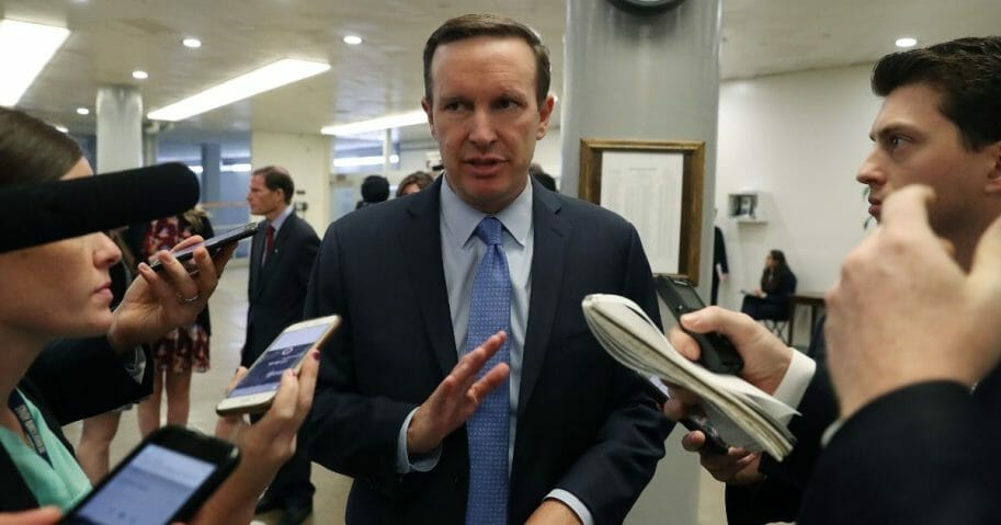Connecticut Sen. Chris Murphy meets with reporters on Capitol Hill in September.