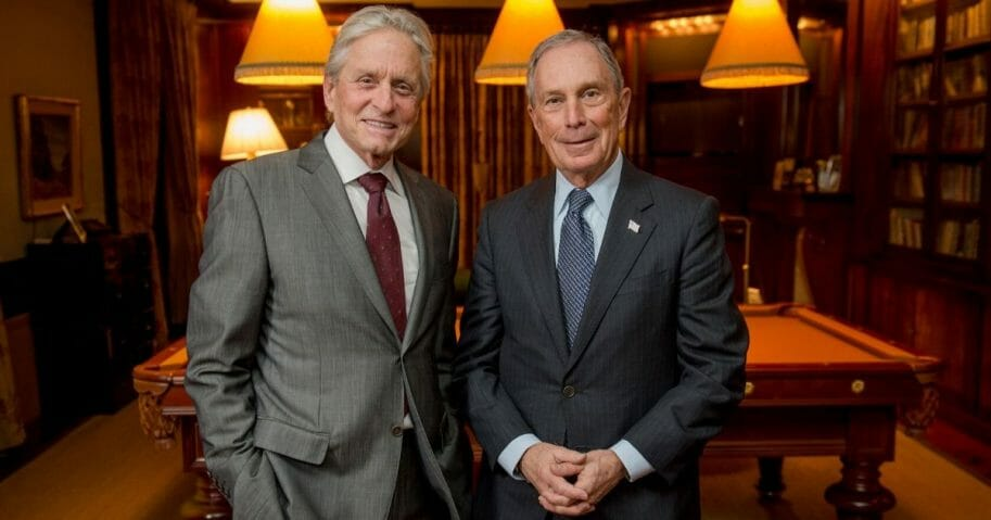 In this handout photo provided by Genesis Prize Foundation, actor Michael Douglas, left, and former New York City Mayor Michael Bloomberg are photographed at Douglas' home on Jan. 12, 2015 in New York City.