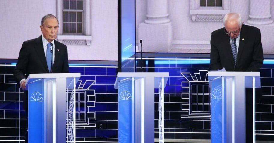 Democratic presidential candidates former New York City Mayor Michael Bloomberg, left, and Vermont Sen. Bernie Sanders take a break during the Democratic presidential primary debate at Paris Las Vegas on Feb. 19, 2020, in Las Vegas.