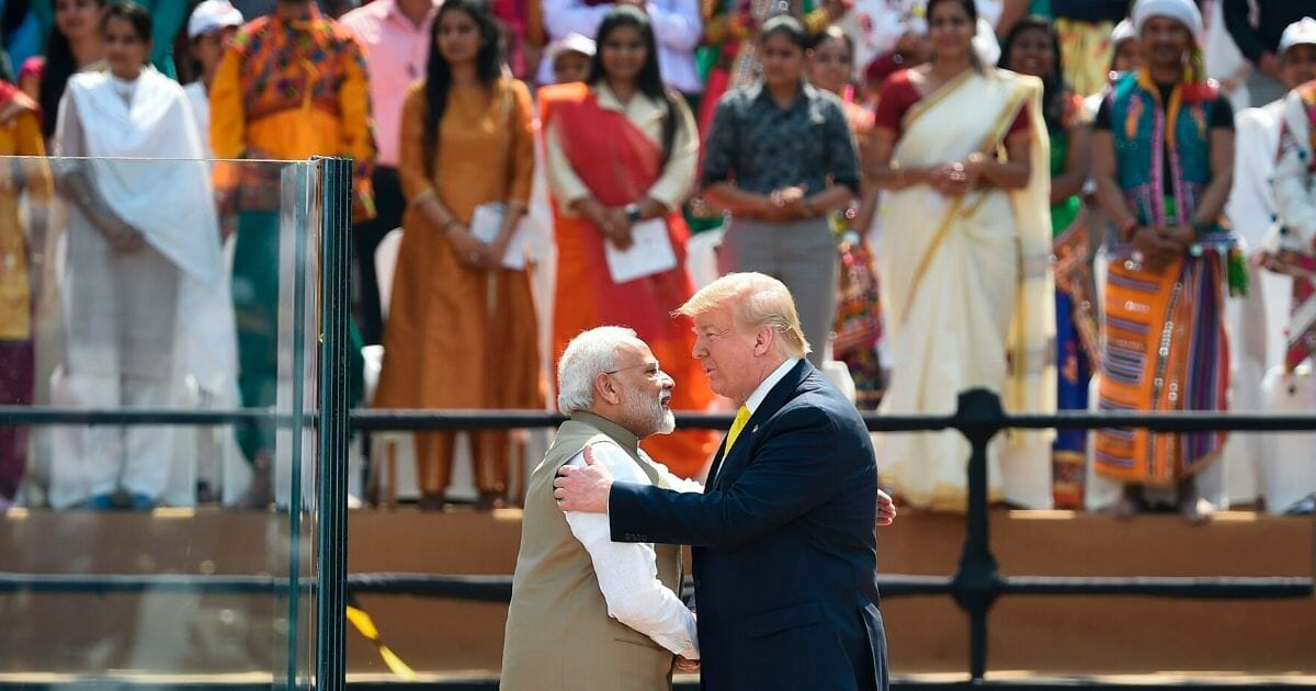 """India's Prime Minister Narendra Modi greets President Donald Trump during the """"Namaste Trump"""" rally at Sardar Patel Stadium on the outskirts of Ahmedabad, India, on Monday."""