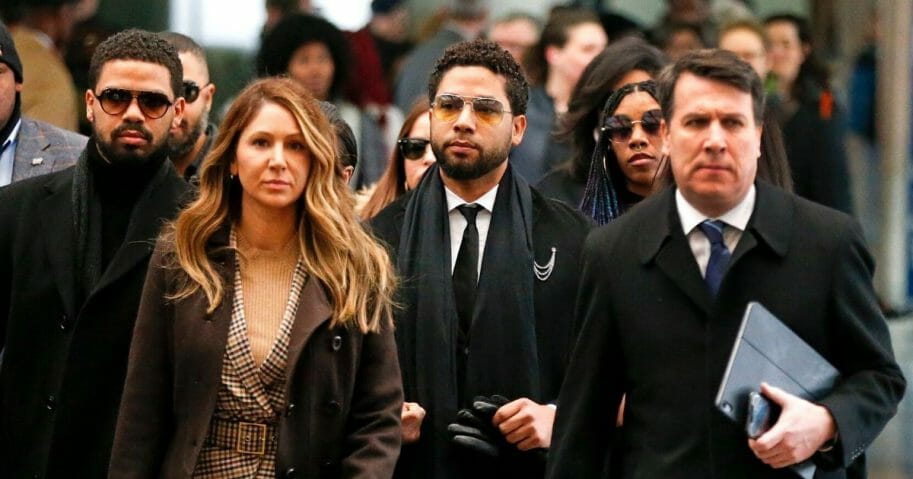 Flanked by attorneys and supporters, actor Jussie Smollett, third from left, arrives at the Leighton Criminal Courthouse on Feb. 24, 2020, in Chicago.