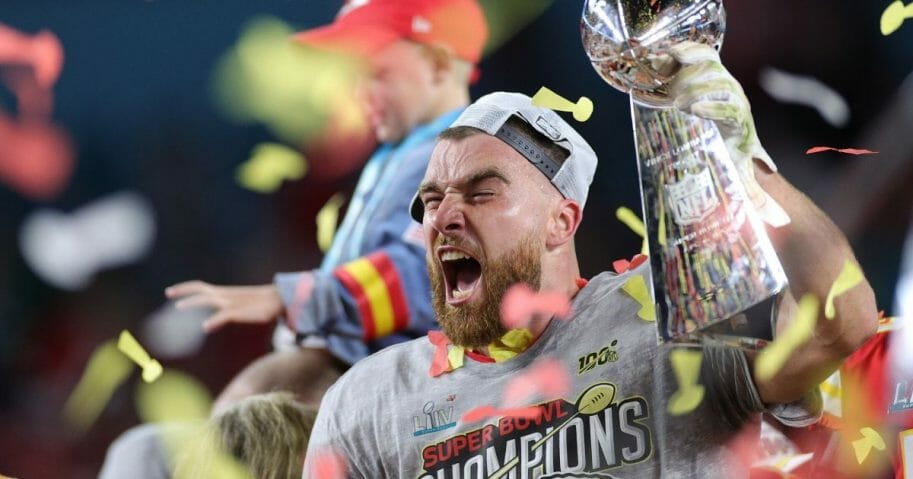 Travis Kelce of the Kansas City Chiefs celebrates with the Vince Lombardi Trophy after defeating the San Francisco 49ers 31-20 in Super Bowl LIV at Hard Rock Stadium on Feb. 2, 2020, in Miami.