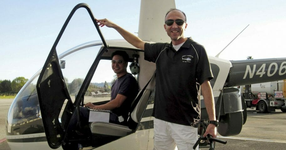 This undated file photo provided by Group 3 Aviation shows helicopter pilot Ara Zobayan standing outside a helicopter, at a location not provided.