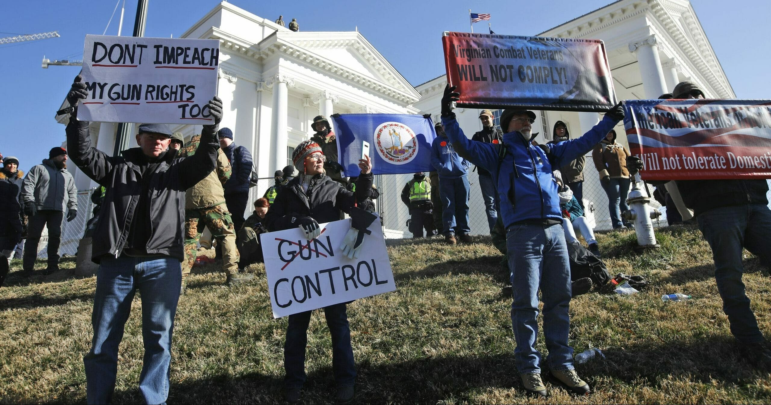This Jan. 20, 2020, file photo shows pro-gun demonstrators holding signs in front of the Virginia State Capitol in Richmond, Virginia.