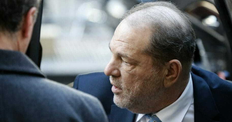 Harvey Weinstein arrives at a New York courthouse as jury deliberations continue in his rape trial on Feb. 24, 2020.