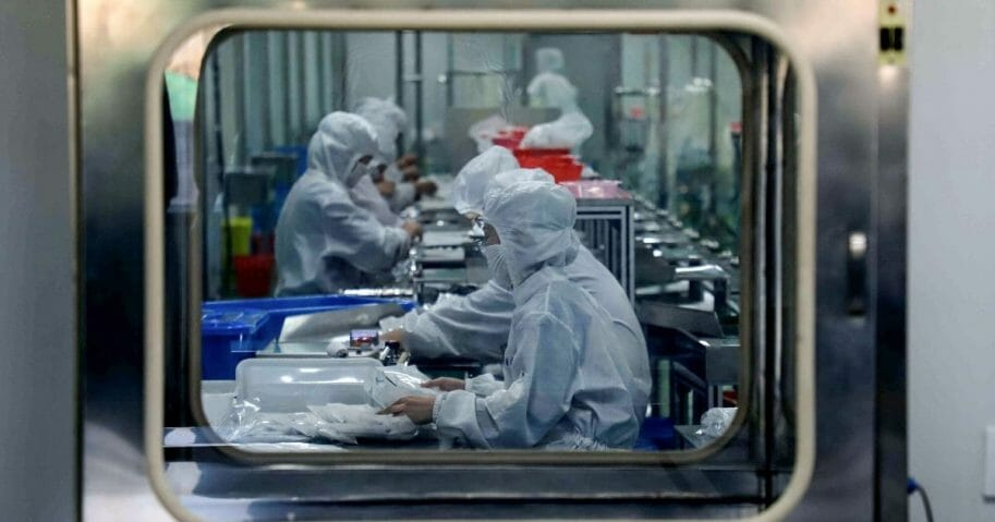 workers producing medical supplies at a factory