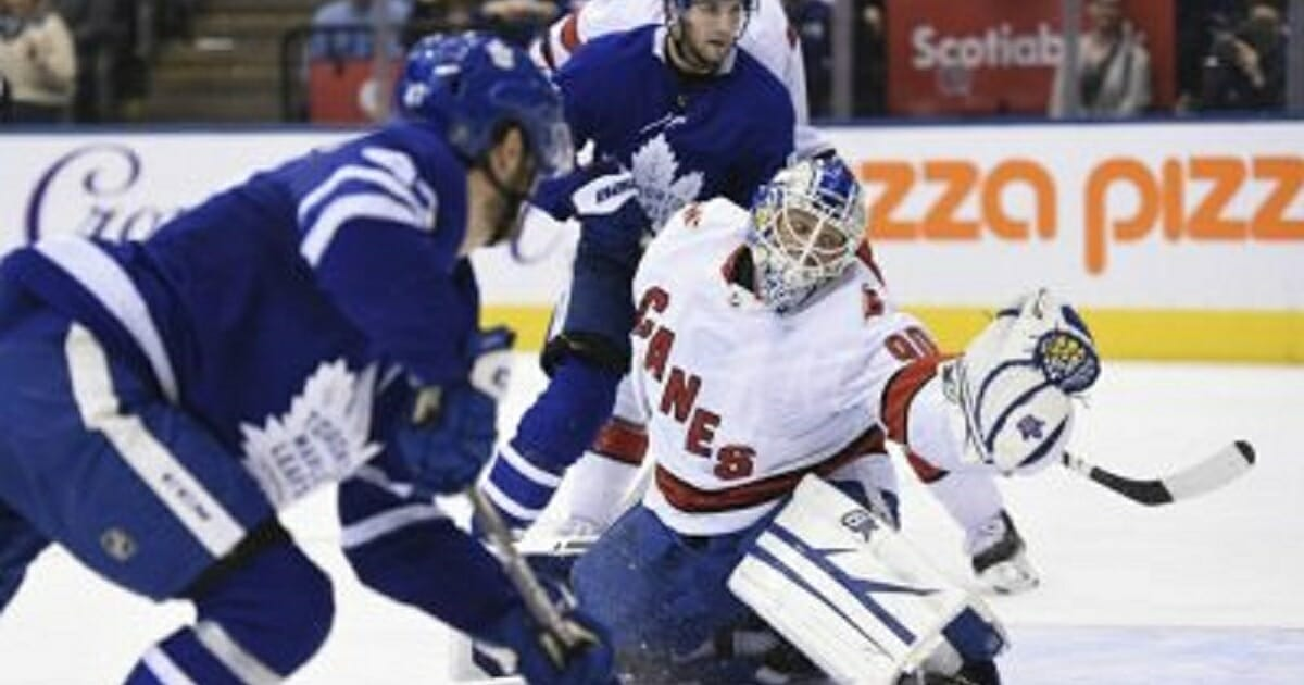 Toronto Maple Leafs left wing Pierre Engvall scores his team's third goal of the game against Carolina Hurricanes emergency goalie David Ayres during second-period NHL hockey game action in Toronto on Saturday.
