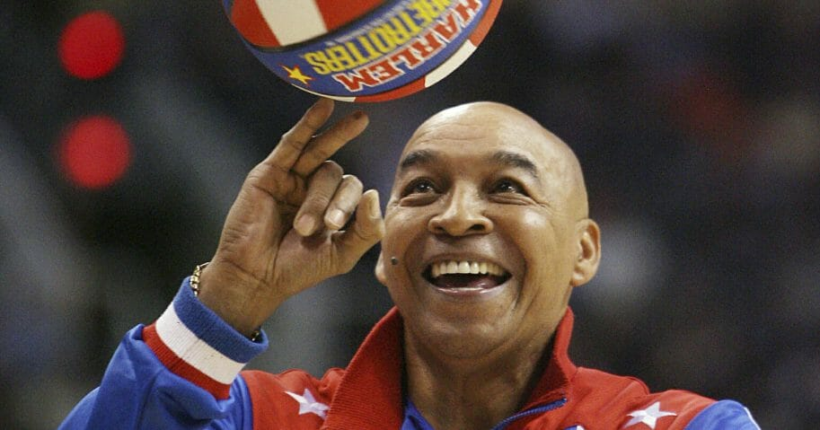 "The Harlem Globetrotters' Fred ""Curly"" Neal performs during a timeout in the second quarter in an NBA game between the Indiana Pacers and the Phoenix Suns on Jan. 9, 2008, in Phoenix."