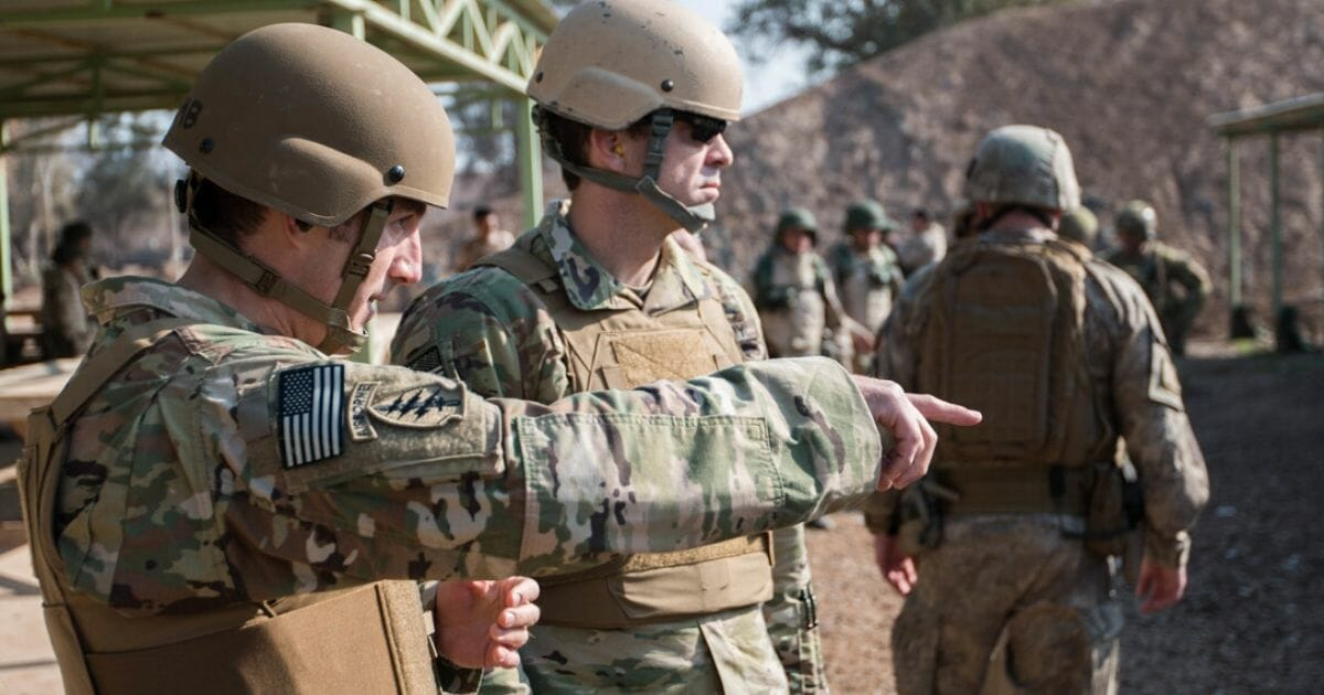U.S. Army Sgt. 1st Class Carson Headley, and U.S. Army Sgt. 1st Class Russell Shields, Office of Security Cooperation Iraq senior-enlisted advisors, Security Sector Reform Group, discuss their observations of Nineva Police weapons training Jan. 24, 2017, Camp Taji, Iraq. Combined Joint Task Force – Operation Inherent Resolve, aims to enable and equip local forces to defeat ISIL in Iraq.
