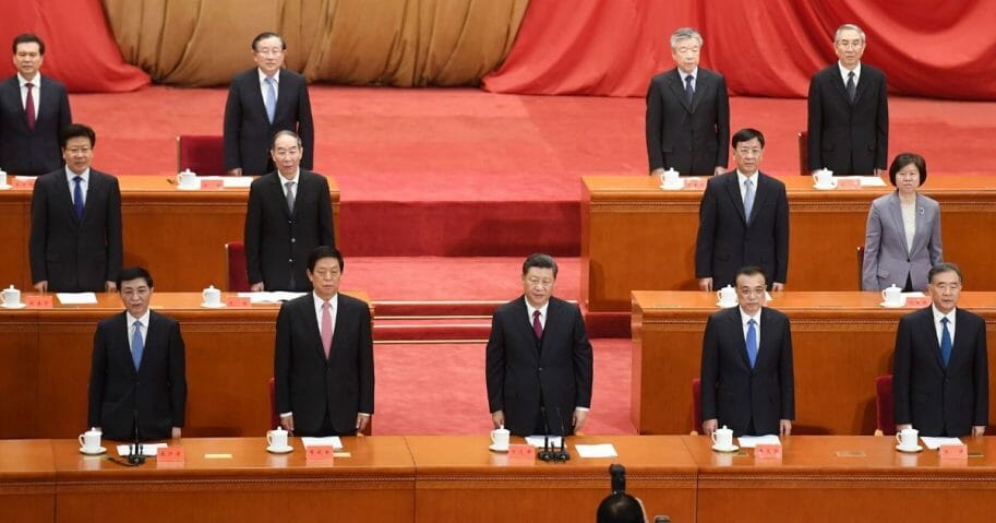 Chinese President Xi Jinping, center, and other Communist Party leaders sing the national anthem in Beijing's Great Hall of the People on April 30, 2019.
