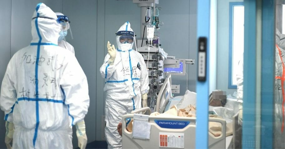 Li Lanjuan, a professor on Beijing's team of coronavirus experts, waves while checking the ICU ward at the Wuhan University hospital on Feb. 20, 2020.