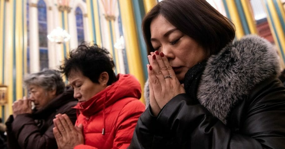 Worshipers attend a Christmas Eve mass at the Xishiku Cathedral in Beijing on Dec. 24, 2019.