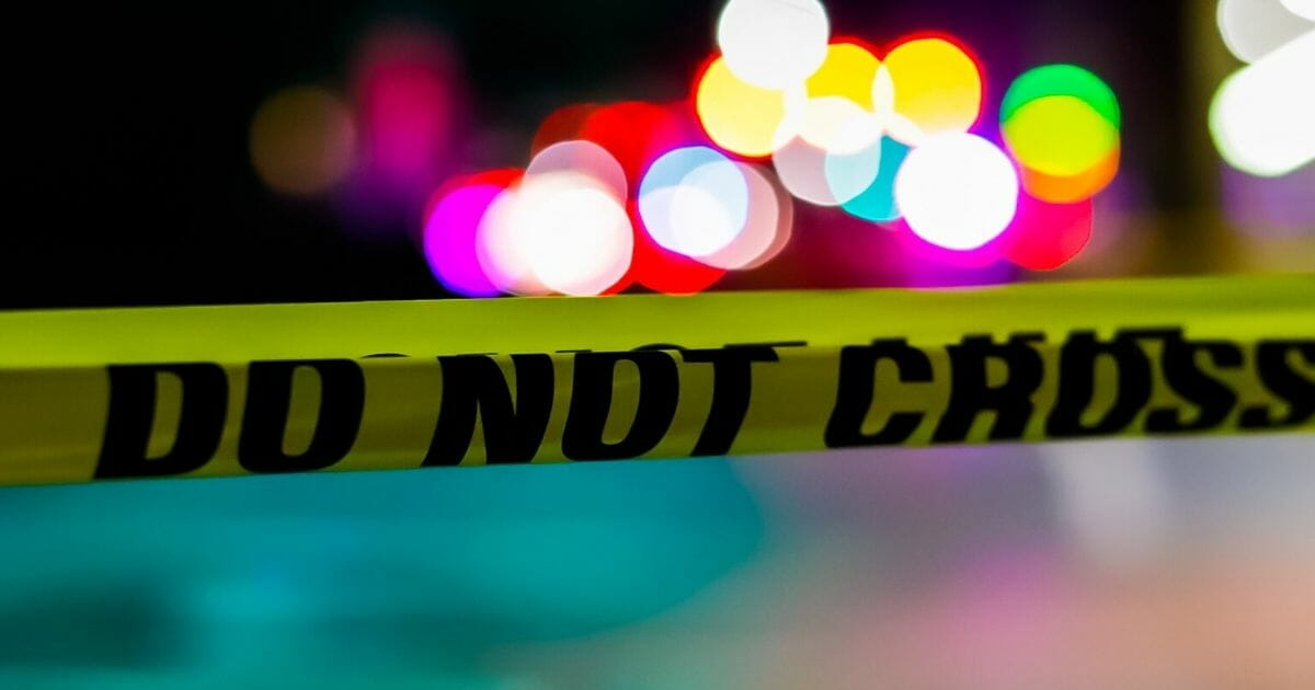 A stock photo of crime scene tape is seen above.