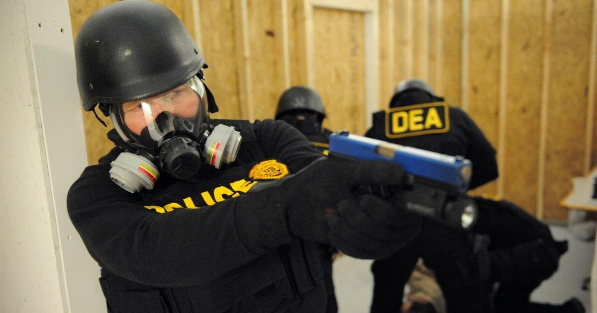 Drug Enforcement Administration agents simulate a raid in their Tactical Training Facility, part of the National Clandestine Laboratory Training and Research Facility on Dec. 5, 2008, at the DEA Training Academy in Quantico, Virginia.