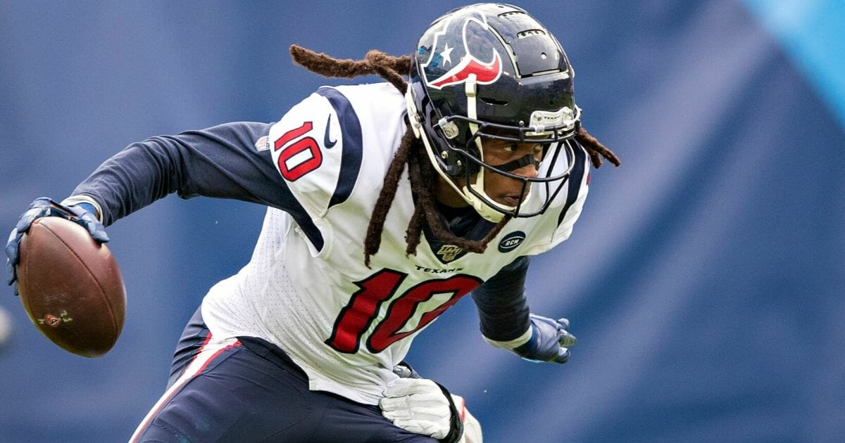 DeAndre Hopkins runs the ball after catching a pass during the Houston Texans' game against the Tennessee Titans at Nissan Stadium on Dec. 15, 2019.