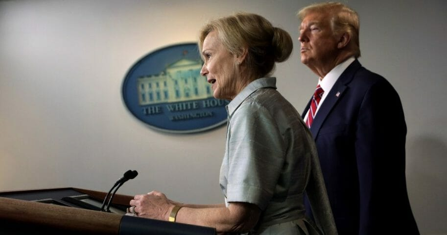 White House coronavirus response coordinator Deborah Birx speaks as President Donald Trump listens during a news briefing at the James Brady Press Briefing Room at the White House on March 20, 2020, in Washington, D.C.