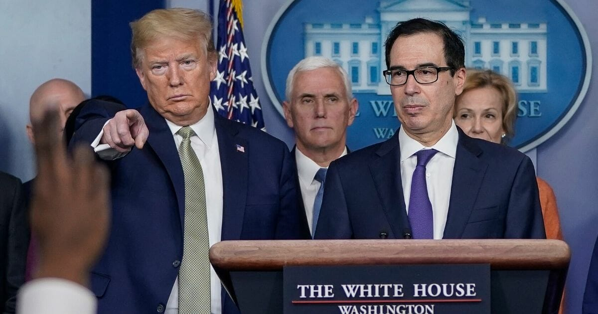 President Donald Trump, left, and Treasury Secretary Steven Mnuchin, joined by members of the coronavirus task force, field questions about the coronavirus outbreak in the briefing room at the White House on March 17, 2020, in Washington, D.C.