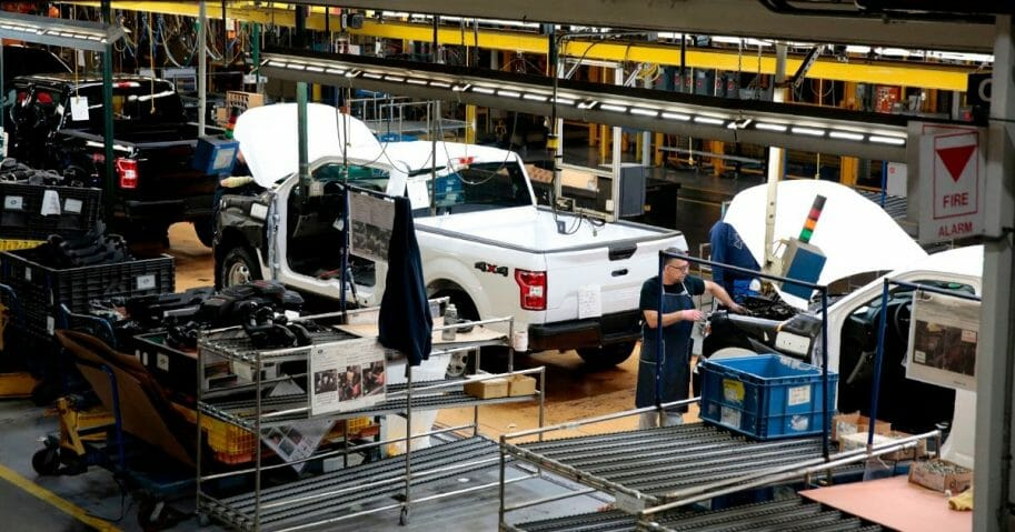 An employee works on the F-150 assembly line at the Ford Motor Co.'s Rouge Complex in Dearborn, Michigan, on Sept. 27, 2018.