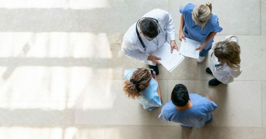 A group of health care professionals are pictured in the stock photo above.