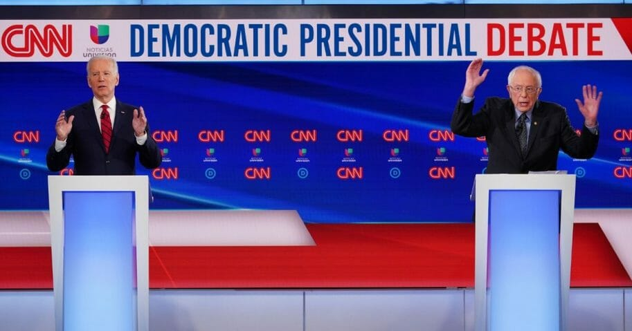 Democratic presidential hopefuls former Vice President Joe Biden, left, and Vermont Sen. Bernie Sanders take part in the 11th Democratic Party 2020 presidential debate in a CNN Washington bureau studio in Washington, D.C., on March 15, 2020.