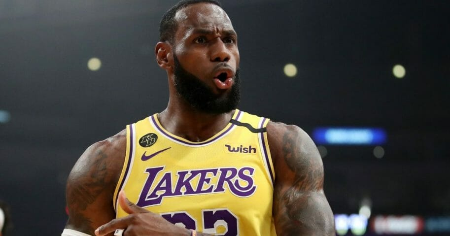 LeBron James #23 of the Los Angeles Lakers reacts to a play against the Philadelphia 76ers during the first half at Staples Center on March 3, 2020, in Los Angeles, California.