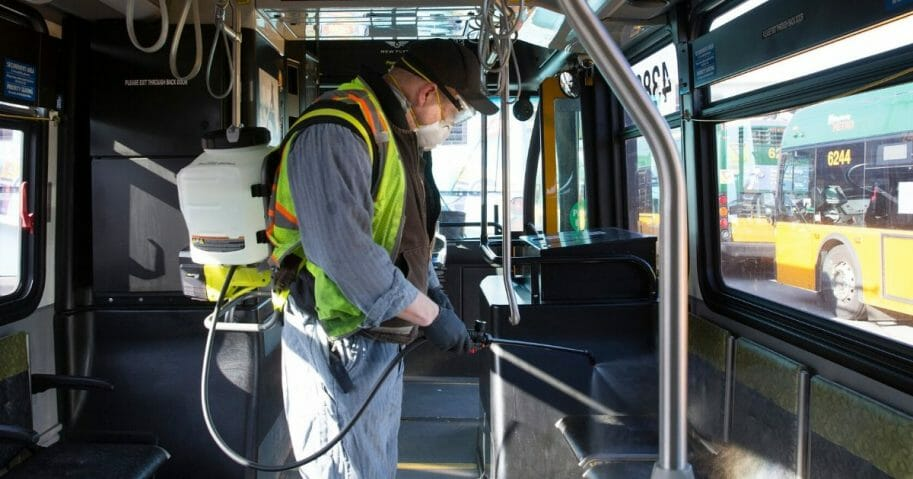 Larry Bowles, an equipment service worker for King County Metro, sprays Virex II 256, a disinfectant, throughout a metro bus at the King County Metro Atlantic/Central operating base on March 4, 2020, in Seattle, Washington.