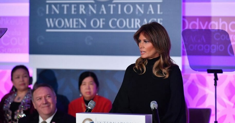 First lady Melania Trump speaks during the annual International Women of Courage Awards at the State Department in Washington, D.C., on March 4, 2020, as Secretary of State Mike Pompeo, left, looks on.