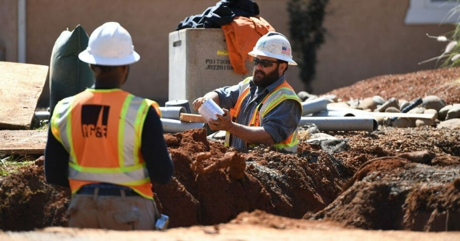 Pacific Gas & Electric Co. workers install a conduit for underground electric lines in Paradise, California, on Oct. 1, 2019.