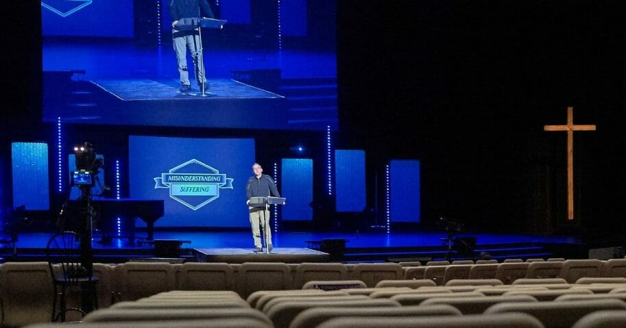 Senior Pastor Troy Dobbs preaches to empty seats