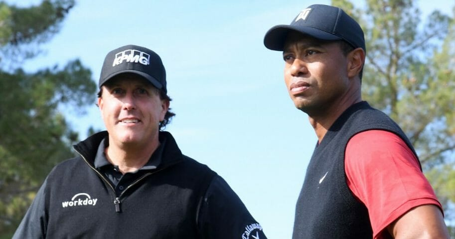 Phil Mickelson, left, and Tiger Woods look on prior to The Match: Tiger vs. Phil at Shadow Creek Golf Course in Las Vegas on Nov. 23, 2018.