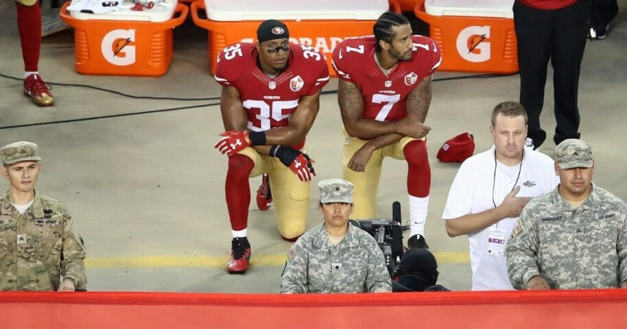 Eric Reid, left, and Colin Kaepernick kneel in protest during the national anthem prior to the San Francisco 49ers' game against the Los Angeles Rams on Sept. 12, 2016, at Levi's Stadium in Santa Clara, California.