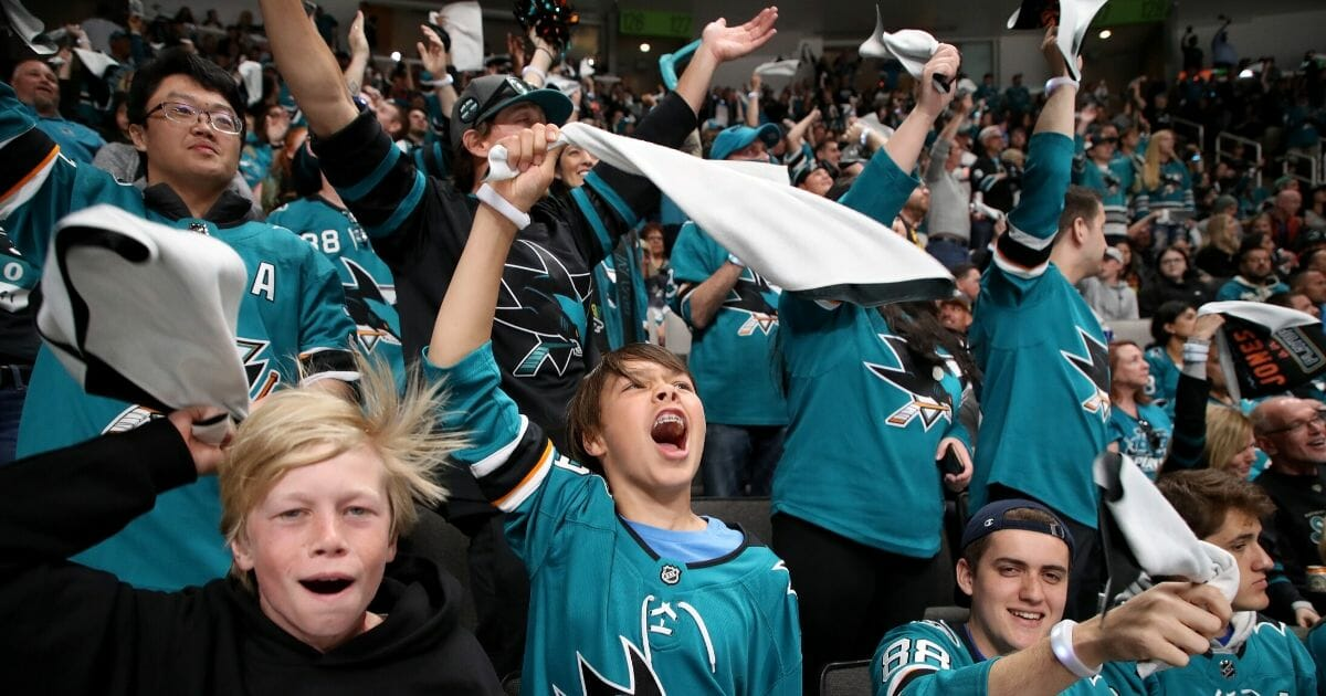 San Jose Sharks fans cheer after their team defeated the St. Louis Blues in Game One of the Western Conference Finals at the SAP Center on May 11, 2019.