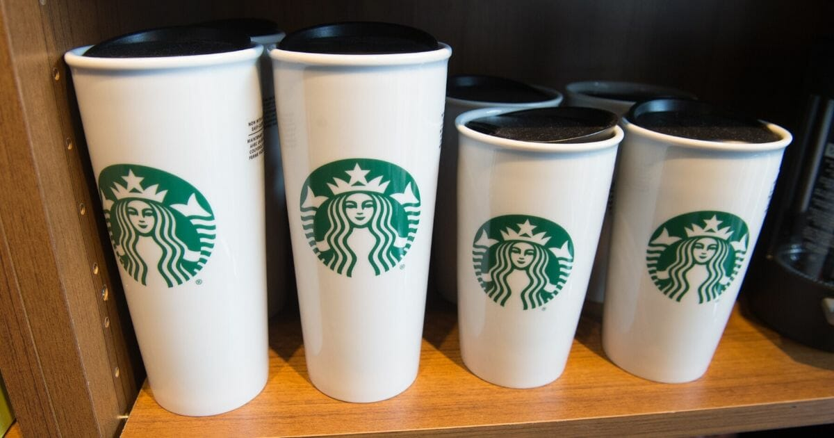 Starbucks coffee mugs are for sale inside a Starbucks Coffee shop in Washington, D.C., on April 17, 2018.