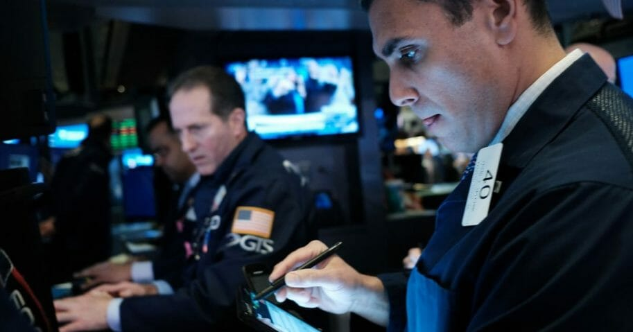 Traders work on the floor of the New York Stock Exchange on March 2, 2020.