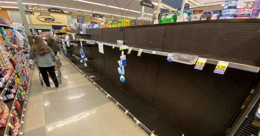 Empty shelves are found at a Kroger grocery store in Grosse Ile, Michigan, on March 13, 2020.